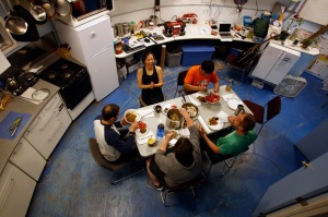 Crew members eating together inside the Hab at the MDRS